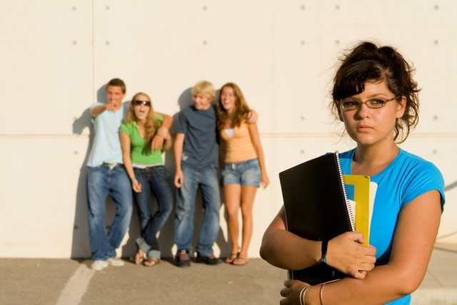 group of bulllies bullying lonely student