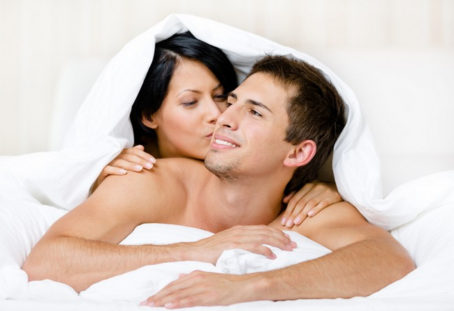 Close up view of couple playing in bedroom
