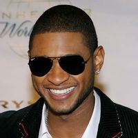 Usher, amenintat de Chris Brown