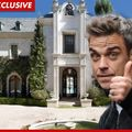 Robbie Williams, interesat  de casa lui Michael Jackson