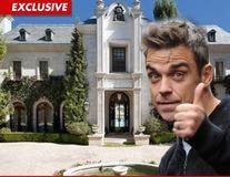 Robbie Williams, interesat  de casa lui Michael Jackson