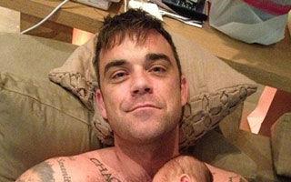 Prima poză cu Robbie Williams şi fetiţa lui