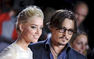 Johnny Depp s-a logodit cu Amber Heard