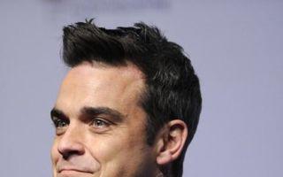Robbie Williams se înfometează ca să slăbească