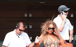 Mariah Carey, la un pas să cadă în nas, de faţă cu paparazzii - FOTO