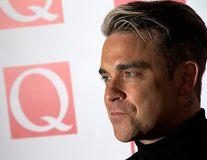 Robbie Williams vrea să revină în grupul Take That