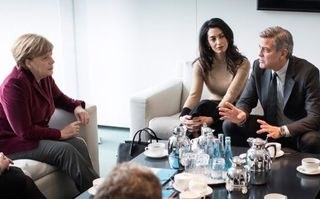 George Clooney a discutat cu Angela Merkel despre criza refugiaţilor