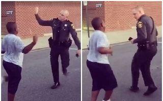 Ce se întâmplă când un puşti provoacă un poliţist: Cine dansează mai bine? - VIDEO