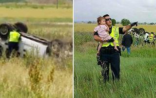 O imagine cât o mie de cuvinte! Ce face un polițist ca să distragă atenția unei fețite de la mașina răsturnată cu familia ei