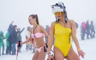 Pe pârtie, în costum de baie: Rușii se distrează la Festivalul Zăpezii