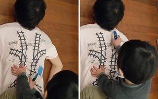 Cel mai inventiv tată din lume! A creat un tricou prin care îşi determină copilul să-i facă masaj